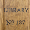 "sara: wood cabinet with ""Library No. 137"" burned on it (library 137)"