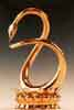 leora: a statue of a golden snake swallowing its own tail. (ouroboros)
