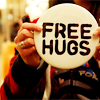 leish: [stock] someone holding up a badge saying 'free hugs' (Default)