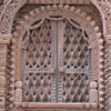 squirrelhaven: intricately carved wooden doors, closed (peacockdoor)