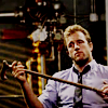 highlander_ii: Danno Williams holding a cane across his chest as he sits in a chair ([Danno] w/ a cane)