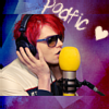 "sylvaine: Gerard with microphone and headphones with the caption ""podfic"" & a heart. ([!band:MCR] Gerard podfic is love)"