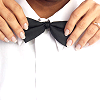 angelikitten: Hands with painted fingernails tying a bowtie (Queer - Going Out)