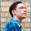 mishalak: Mishalak with short hair wearing a blue shirt and looking upwards. (Blue)