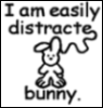 "red_trillium: picture of a drawing of a bunny and words ""I'm easily distract...a bunny"" (distracted by bunny)"