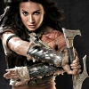 sharpest_asp: Dejah Thoris holding a sword pointed down, arms crossed in front of her face (Barsoom: Dejah Thoris with Sword)
