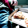jsem: stock photo:  young man with pizza (starved on the day-old)
