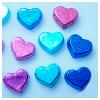 chalcopyrite: Shiny blue and purple hearts on a blue background (♥)