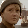 sharpiefan: A ship's boy with a tall ship in the background (Terry Button)