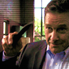 scripted_sra: Larry holding his knife, mid-gesture, waving goodbye. (burn notice: larry & his knife wave bye)
