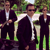 scripted_sra: Mike, Sam, and Fi, in suits, standing and looking badass. (Default)