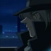 crowsong: Gin viewed from the side. The city at night is in the background. His expression is neutral. (so come on in; it ain't no sin;)