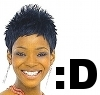 eldabe: A picture of Caroline Chikezie smiling, with a smiley symbol (Caroline Chikezie Smiling)