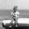 ext_15118: Me, on a car, in the middle of nowhere Eastern Colorado (childhood)