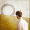 em_kellesvig: Sheppard in white shirt, looking at a stargate (SGAJSAlienGate)