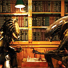 swordage: Predator and Xenomorph playing chess in a library. (asst silly rabbi)