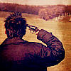 swordage: A man pointing a revolver at his own head in sepia. (x space amish nazis)