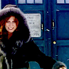 laurashapiro: Donna runs happily in her winter coat; the TARDIS is in the background (donna)