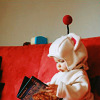 tehkittykat: baby dressed in moogle costume with book (ff; baby moogle)