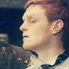 randomling: Turlough (of Doctor Who) looks to the left with his eyes half-closed. (turlough)