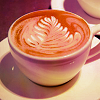 the_coffee_shop: A mug of coffee with a leaf-like swirl in its center. (whit)