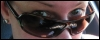 pure_dead_brilliant: Photo of me looking over my sunglasses. (Default)