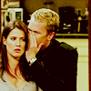 sloth: from how i met your mother, barney is whispering into robin's ear (this is a secret)