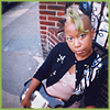 klgaffney: young black punk rock girl with shaved head, green devilock and guitar. (punk's not dead.)