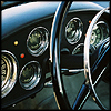 klgaffney: photo detail of an alpha romeo car dashboard (ymmv - your mileage may vary.)