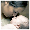 recessional: a woman holds a baby and touches her nose to the baby's (personal; oh holy)