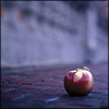distractionary: apple in foreground, out-of-focus bridge in background. (Purple.) (Default)