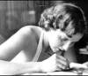 were_duck: a black and white photo of alice sheldon (james tiptree jr.) writing (Tiptree)