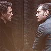 bethbethbeth: Robert Downey Jr as Holmes and Jude Law as Watson, facing each other (Sherlock Ritchieverse (enamelicons))