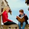 beatrice_otter: Emma and Henry reading the book of fairy tales (Once Upon a Time)