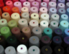 acrylicious: Bobbins of acrylic yarn ganked from image search (Default)