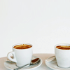 themis: Two cups of coffee. (m: coffee)