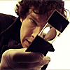 fastidious: Sherlock looking through a collapsible magnifying glass. (Sherlock - Magnified)