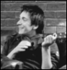 sporky_rat: One of the Phelps brothers with a ukulele in greyscale. (ukuleles are badass)