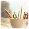 dirty_diana: colored pencils sit in an empty latte cup. (colored pencils)