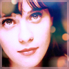 thinkhappythoughts: zooey deschanel with lots of lights (make a wish)
