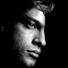 skywardprodigal: bw picture of man's shadowed face and his high angled eyebrow (meme-shipper)