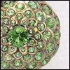 skywardprodigal: ring by rene boivin -- green stones like a chrysanthemum setting (bling-boivin)