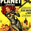 metatxt: scifi serial planet stories, a red headed woman in chain mail swings an axe (art: planet stories)