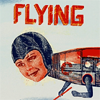 metatxt: text above: FLYING; cyborg with female face and insect body in midair (art: flying)