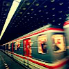 metatxt: red, white, and silver subway car blurred due to its speed (art: fast train)
