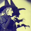 metatxt: profile of Wicked Witch of the West, with shadow behind her (art: wicked)