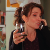metatxt: liz lemon slurring into her phone, holding a glass of wine (30r: drunk dial)