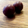 la_fono: A picture of two chocolate orbs, aka maltesers (chocolate orbs)