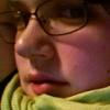 ext_132: Photo of my face: white, glasses, green eyes, partially obscured by a lime green scarf. (me)