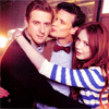 such_heights: matt, karen and arthur hugging with matt making a smoochy face at arthur (who: matt/karen/arthur [smooch])